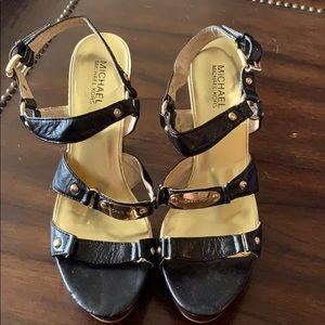 Michael Kors size 9 1/2 black 4 1/2 - 5 inch heel